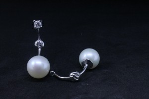 White gold earrings accessorize with fresh water pearls