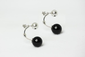 Silver earrings accessorize with onix