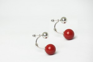 Silver earrings accessorize with coral paste
