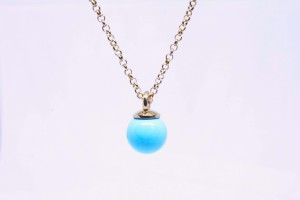 Golden silver pendant with turquoise paste