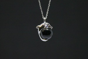 White gold dolphin pendant with onyx