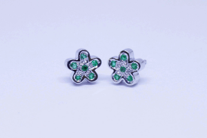 White gold flower earrings with emeralds