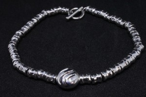Silver bracelet with charm and barilotti