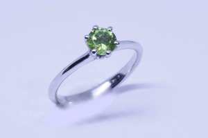 White gold ring with olivine