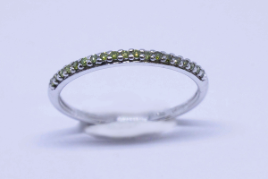 White gold ring with yellow diamonds
