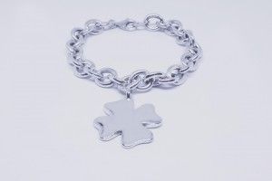 Silver chain bracelet with four-leaf clover
