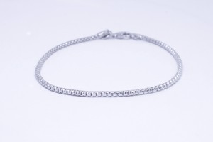 Silver bracelet with chain hooked