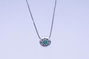 White gold pendant with diamonds and emeralds