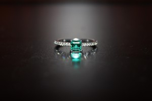 White gold ring with diamonds and emerald